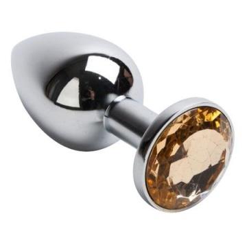 Серебристая анальная пробка с желтым кристаллом - 7,6 см.