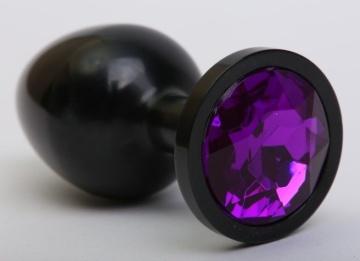 Чёрная анальная пробка с фиолетовым стразом - 8,2 см.